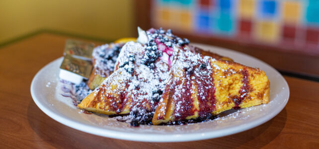 french toast with powdered sugar and berries